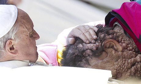 Pope Francis holds a sick person in Saint Peter's Square at the end of his General Audience in Vatic